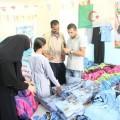 جانب من توزيع زي مدرسي