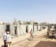 رئيس لجنة المتابعة الحكومية د. محمد عوض يتفقد أعمال تجهيز ١٠٠ غرفة متنقلة للعزل الصحي