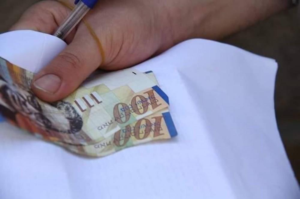 الزكاة تقدم مساعدات نقدية بقيمة 210000 ألف شيكل