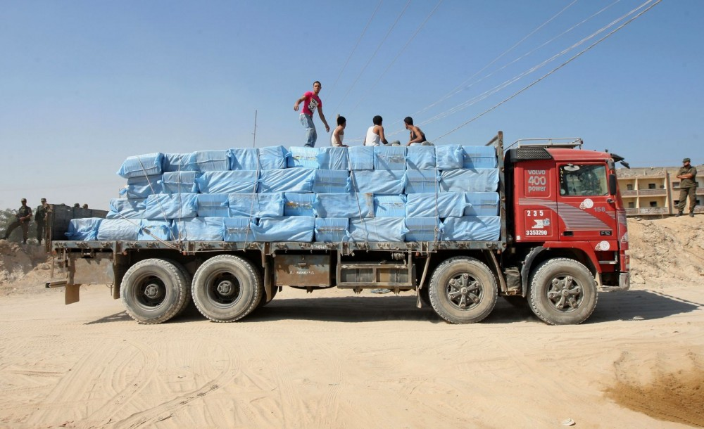 A-Palestinian-truck-carrying-goods-smuggled-through-tunnels-leaves-the-Gaza-Egypt-border-in-Rafah