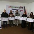 خلال لقاء تسليم شيكات القروض في مقر جمعية روّاد بمدينة غزة