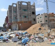 النفايات تملئ طرقات غزة / تصوير / عبد الحكيم أبو رياش