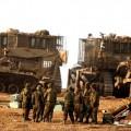 جنود الاحتلال قرب آليات عسكرية
