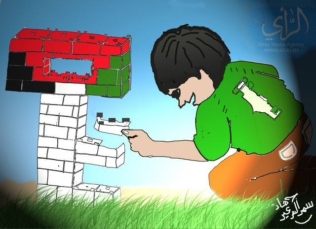 A Palestinian child plays with cubes trying to form 'return key', in hope of a soon return to his town of origin